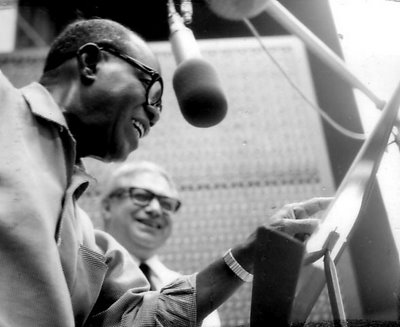 Tutti Camarata in the studio with Louis Armstrong during the 1968 sessions for Disney Songs the Satchmo Way. Tutti: 'When Louis finished recording, I got a letter from him, thanking me for letting him sing 'When You Wish Upon a Star, Makes No Difference Who You Are ...' I almost cried when I saw that.'