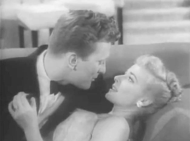 Kirk Douglas takes a meeting with on Laraine Day in 'My Dear Secretary'