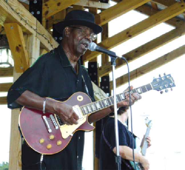 A photo from September 2011 captures Texas Johnny Brown performing in downtown Ackerman, Mississippi, his hometown, after the unveiling of a Mississippi Blues Trail marker in his honor.