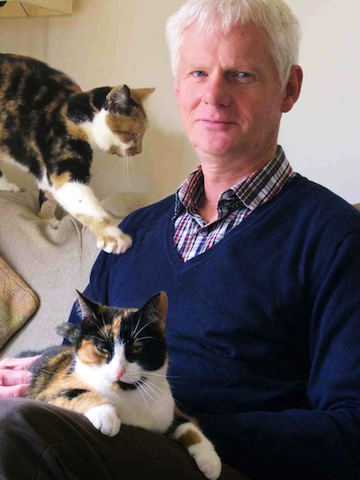 John Bradshaw at home with his cats