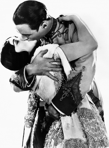 Rod La Roque plants one on Pola Negri in the 1924 silent film Forbidden Paradise