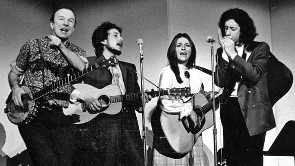 Pete Seeger, Bob Dylan, Judy Collins and Arlo Guthrie performing at a Woody Guthrie tribute concert in New York, January 20, 1968, at which proceeds went to benefit research into Huntington's disease, the disease that had killed Woody less than a year earlier, on October 3, 1967.
