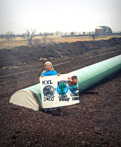 Oklahomans from across the state, and indigenous and environmental activists came together and walked onto an easement where pipe for the Keystone XL tar sands pipeline was being laid through Sac & Fox land. In solidarity with the international Idle No More movement, the Unis'tot'en Camp, impacted communities throughout the pipeline route and an Oklahoma branch of Tar Sands Blockade have come together to take nonviolent action against the dangerous pipeline and demand that tribal sovereignty, native burial lands and property rights be respected by TransCanada. The action took place in Stroud, OK, where the group walked onto a TransCanada easement and marched along segments of buried and unburied pipe, participating in round-dances along the way.