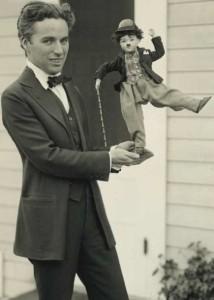 Charlie Chaplin with a Charlie Chaplin doll, 1918