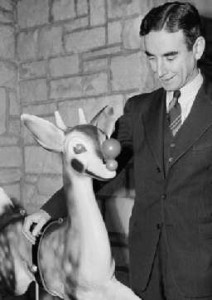 Robert May with his creation, Rudolph