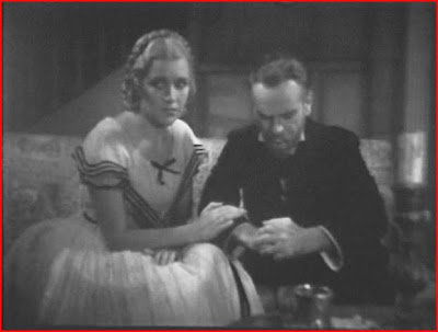 The big suspense moment in Condemned to Live comes when Marguerite (Marguerite Mane) gradually blows out all the candles in her living room to soothe Prof. Kristan's (Ralph Morgan) tired eyes, not realizing (despite his warnings) that darkness triggers his fiendish transformation.