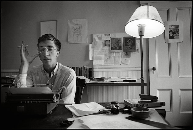 A young John Updike writing in his office. (Photo: Ipswich.wordpress.com)