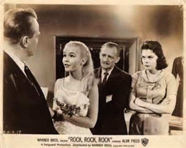 (from left) Jack Collins as Father, Tuesday Weld as Dori, Lester Mack as Mr. Bimble and Jacqueline Kerr as Gloria uncover Dori's loan scam in Rock, Rock, Rock!