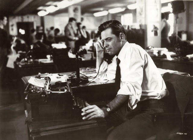 William Holden as reporter Jerry McKibbon in The Turning Point