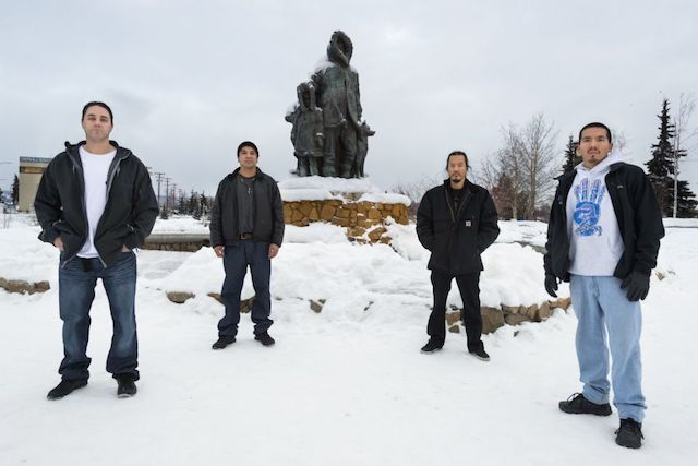 The Fairbanks Four (from left): Kevin Pease, Eugene Vent, George Frese, and Marvin Roberts stand in front of Malcolm Alexander's Unknown First Family sculpture. 'Their true crime was diversity: Alaska Natives and a Native American, this quartet looked as people of privilege felt—and persist in feeling—that criminals look.' (Photo: Keri Oberly, published in Pacific Standard)